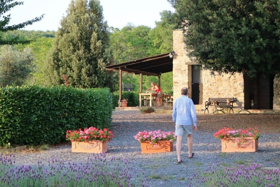 Daniela prepares the dining table for dinner al fresco at Antica Olivaia, Umbria Agriturismo