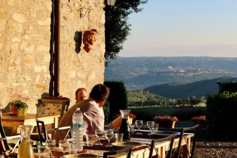 Dining al fresco at an Umbria agriturismo, with a view of Orvieto in the distance