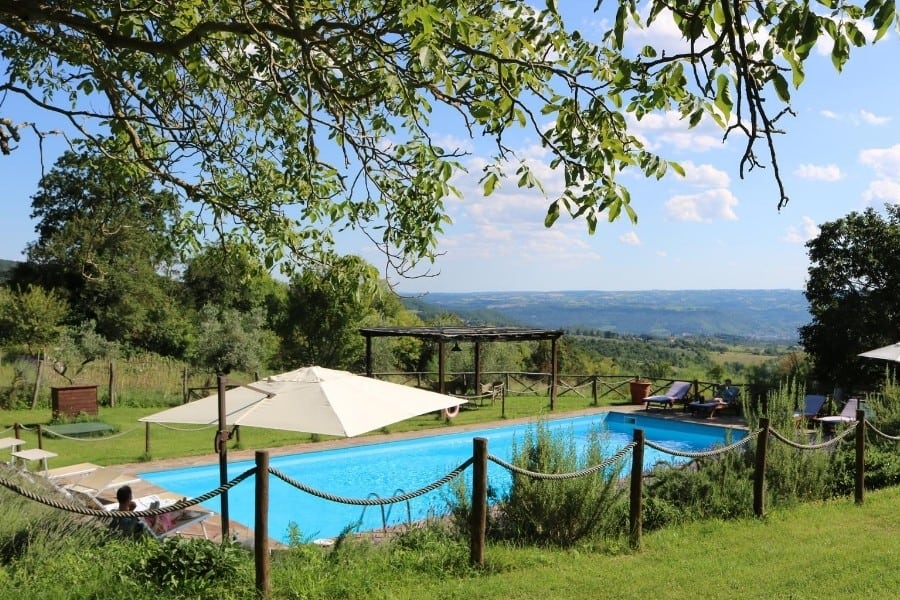 The swimming pool at Antica Olivaia with views of the Umbrian hills and the town of Orvieto