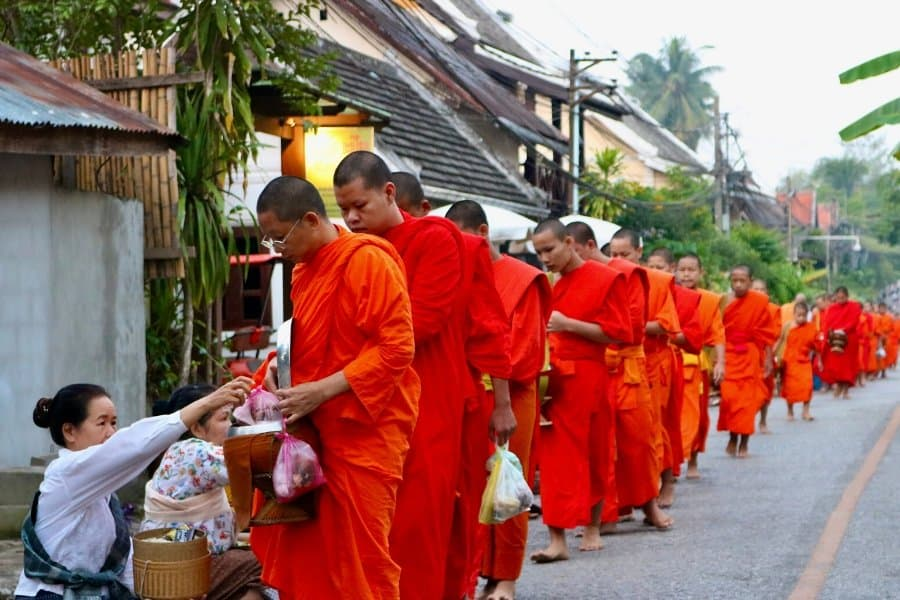 alms giving to monks in luang prabang