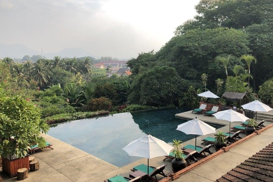 view from the pool at belmond luang prabang laos