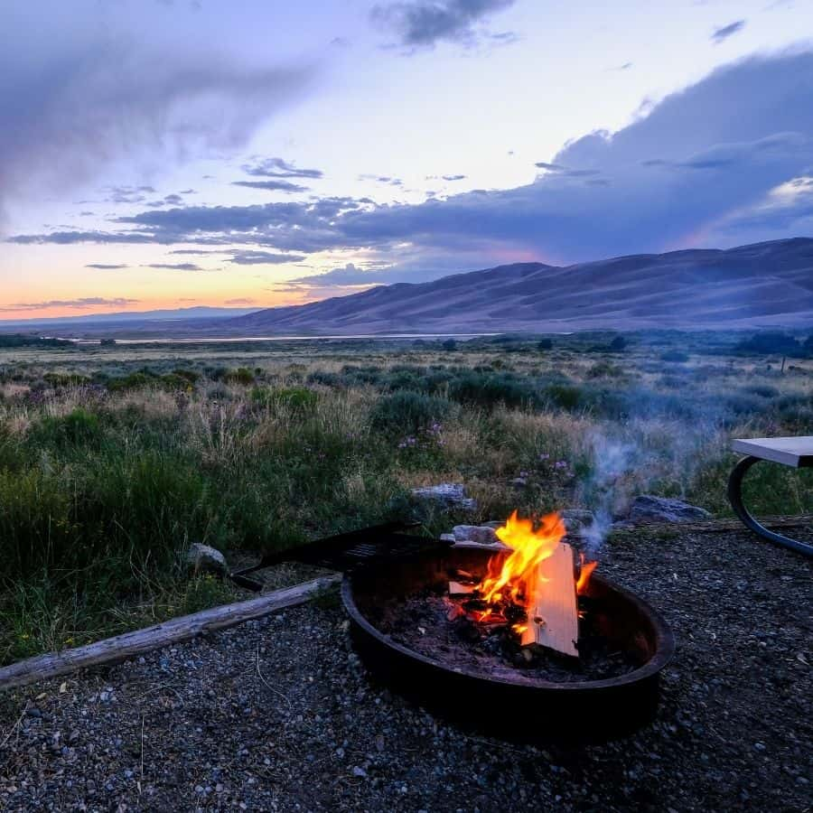 A campfire with view of the Great Sand Dunes National Park