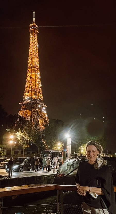 Susan Heinrich on a Bateaux Parisiens Cruise in Paris with a view of the Eiffel Tower just behind her