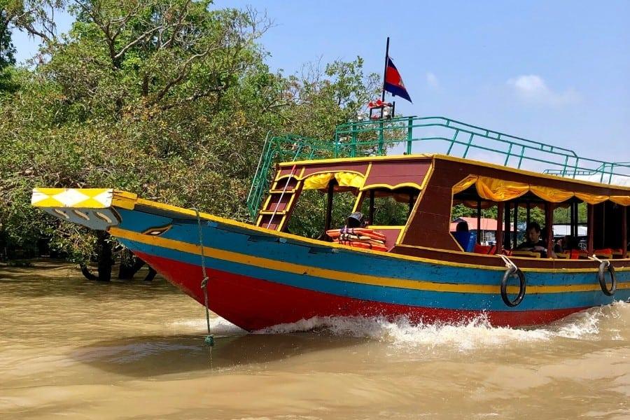colourful boats tonle sap cambodia
