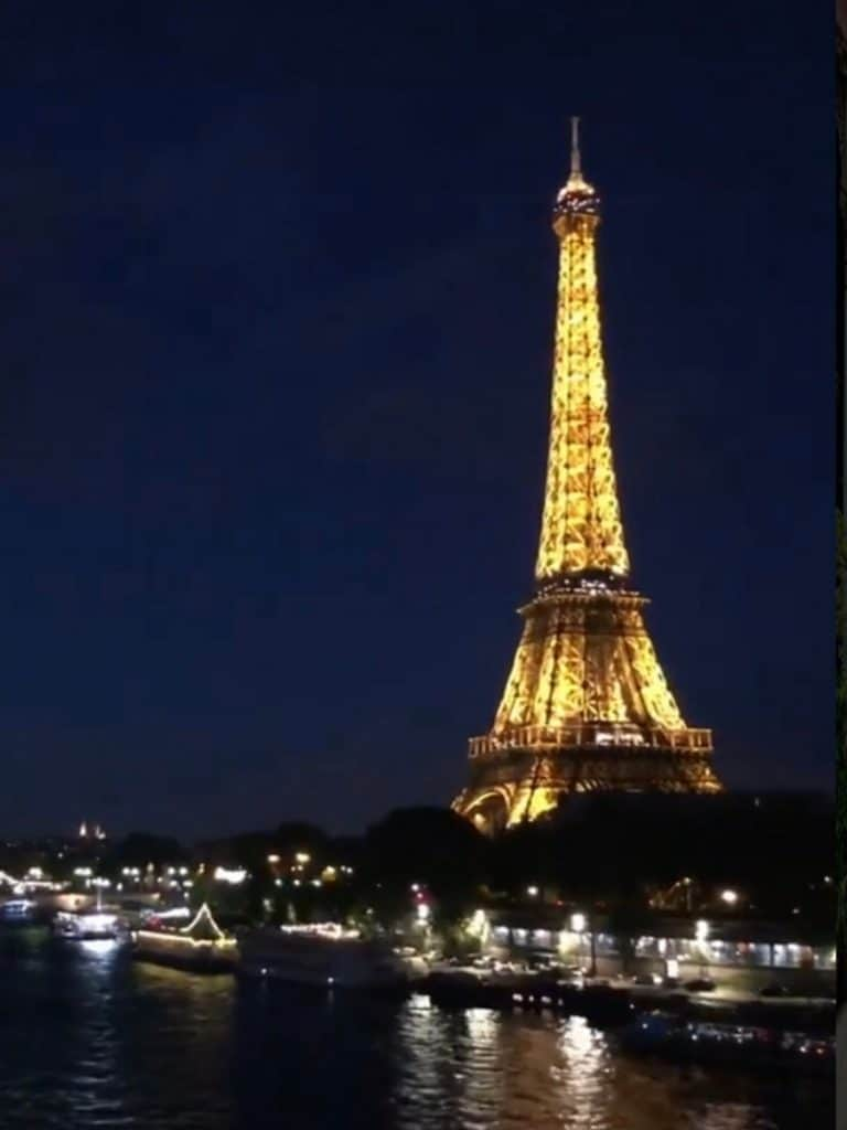 see the eiffel tower at night from the metro