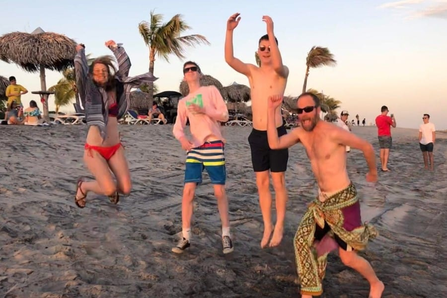 Jumping with my family on the beach, feeling healthy after hip replacement