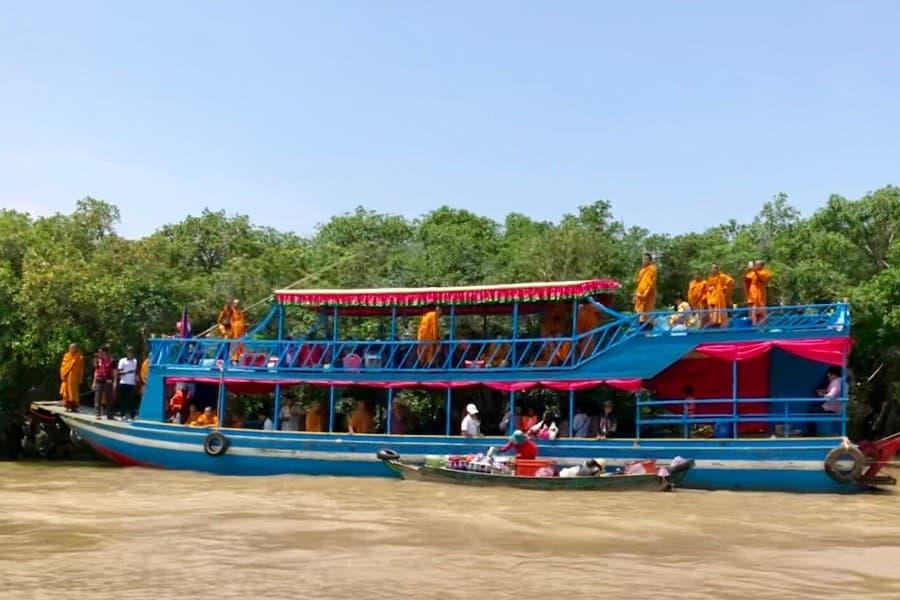 monks on tonle sap river
