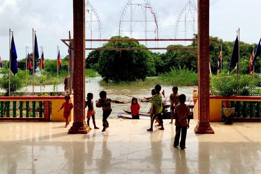 children play at village temple kampong phluk