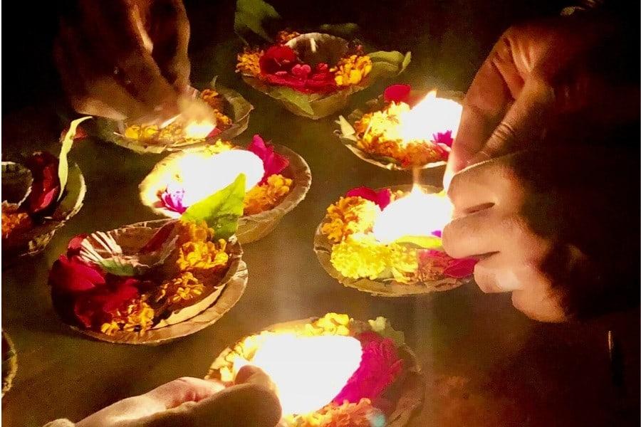 lighting the aarti on the ganges in varanasi