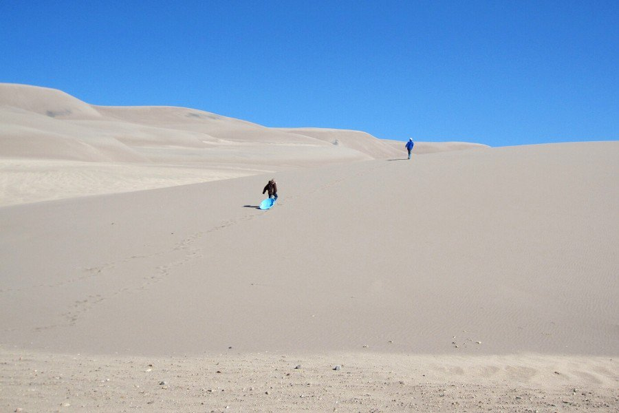 kids climbing the great sand dunes