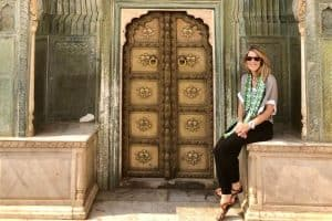 Susan sitting at the leheyria spring gate, at city palace jaipur