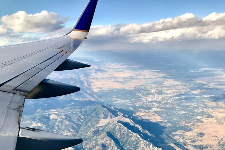 view over the rocky mountains from an airplane