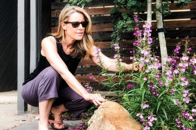susan in her garden in denver, happy at midlife