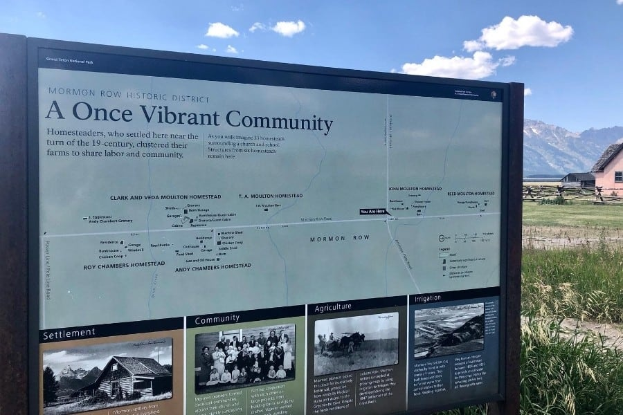 A sign describes the history of the homestead settlements at Mormon Row in Wyoming