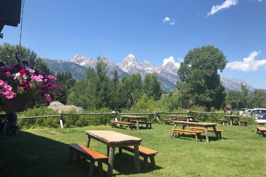 Picnic tables offer a Teton mountain view at the Chuckwagon restaurant in Dornans