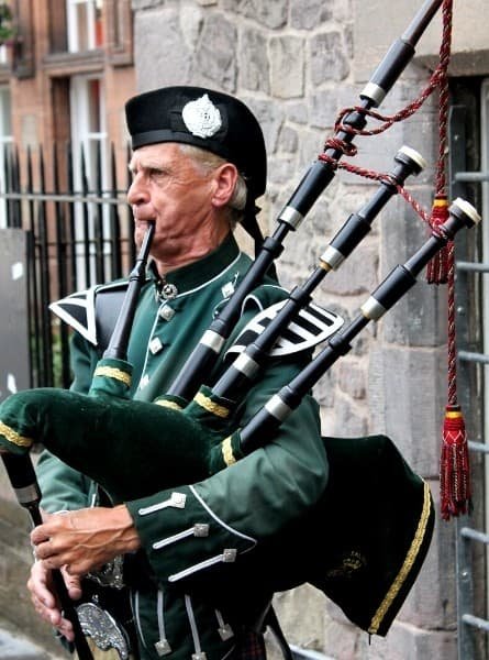 A man plays the bagpipes in Scotland