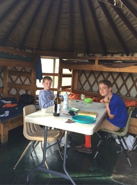 Two boys play a card game inside a Yurt in State Forest State Park