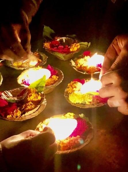Lighting aarti candles in Varanasi India