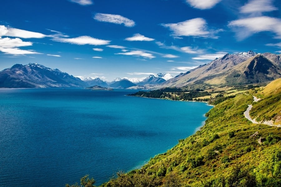 The New Zealand coastline with green hills and a blue sea