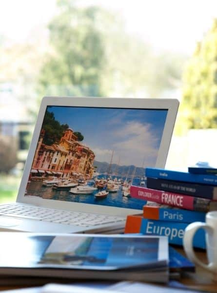 Researching how to afford travel with a laptop and Europe guide books