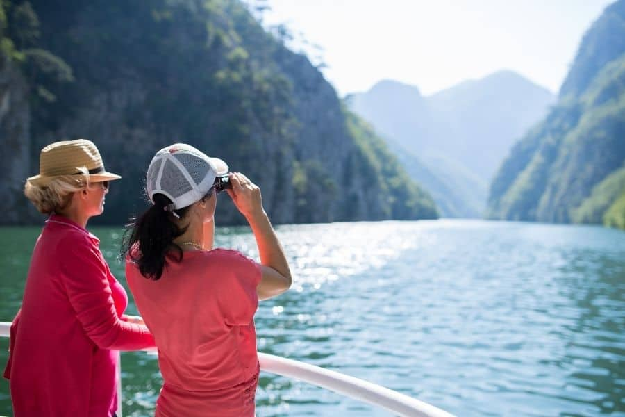 women on a group trip enjoy a scenic view
