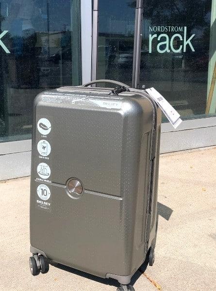A Delsey Turenne carry-on bag outside of Nordstrom Rack