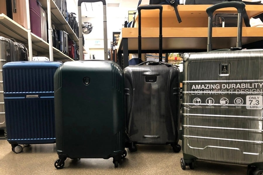 Carry on bags stand next to each other