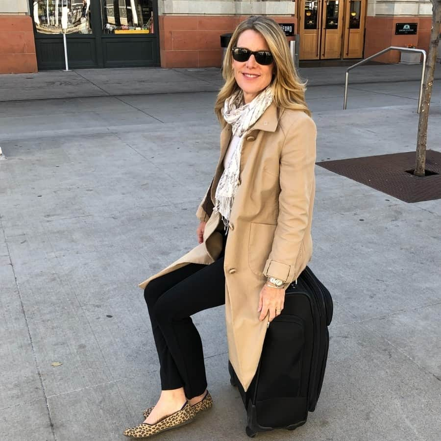 Susan sits on her Samsonite carry on which weighs 10 pounds