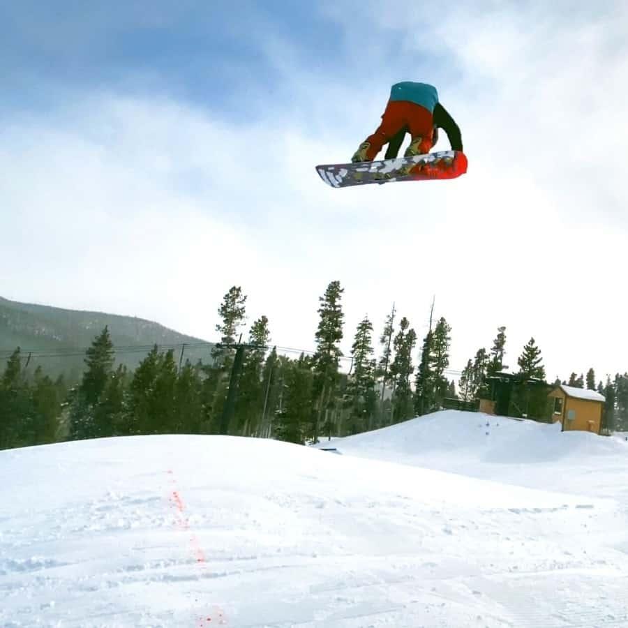 A snowboarder in the air at Eldora Ski Resort