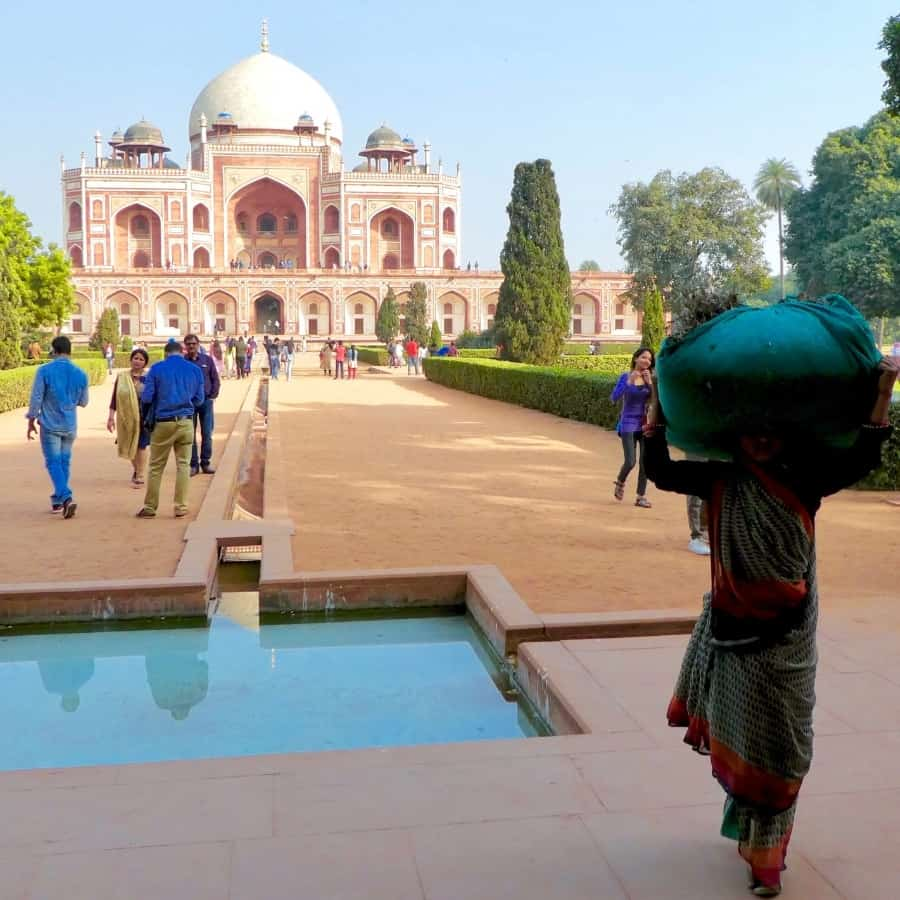 Indians walk in front of Humayun Tomb, one of the most famous historical places in Delhi