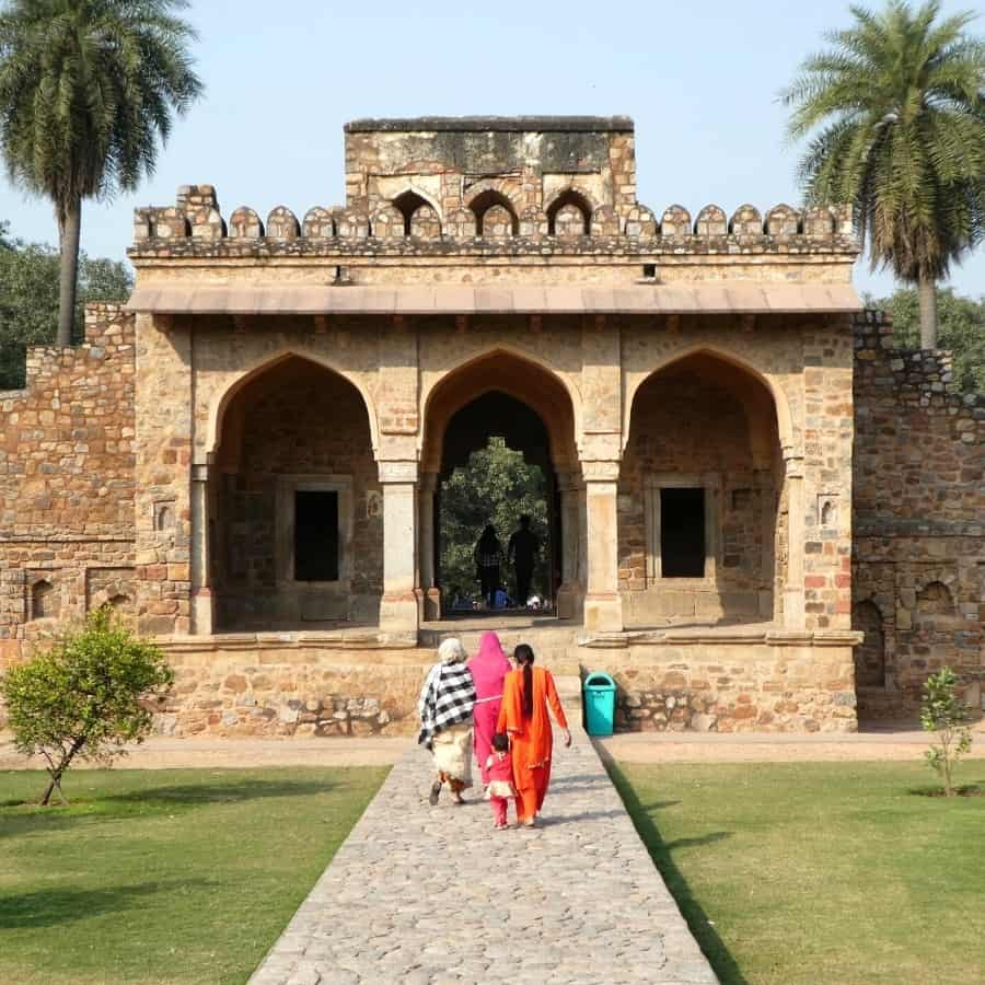 Indian women walk within the Humayun's Tomb Complex in Delhi, India