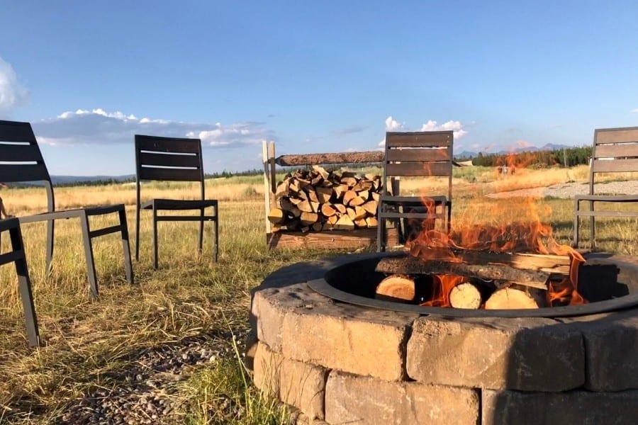 A campfire at Under Canvas for cooking smores
