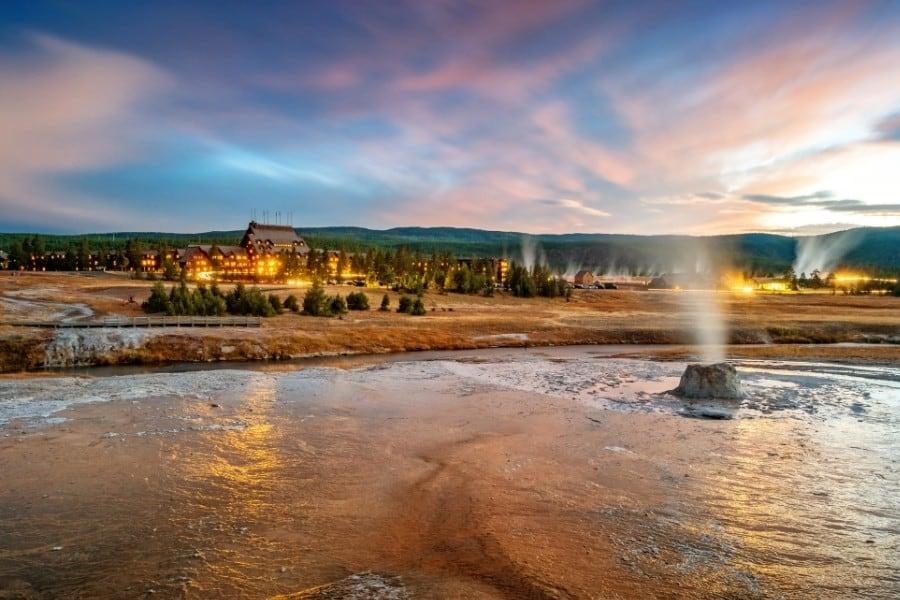 Old Faithful geyser with the Old Faithful hotel beyond