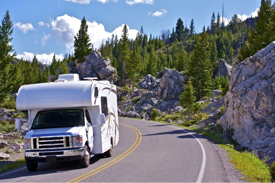 An RV drives in Yellowstone