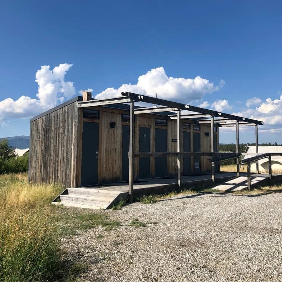 A building at Under Canvas Yellowstone has showers and toilets for guests staying in the safari tents