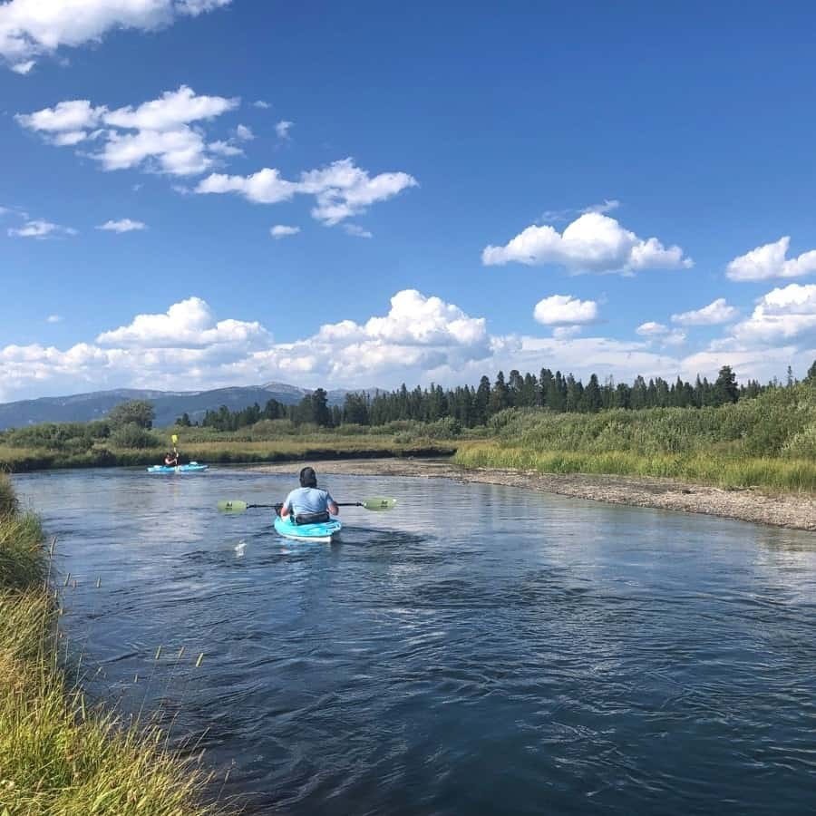 Kayaking on a river at Under Canva Yellowstone