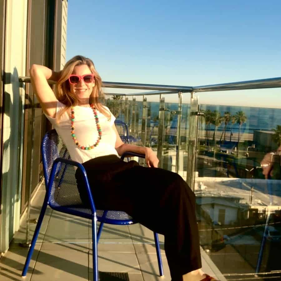 Susan Heinrich sits on a balcony at the Hotel Erwin Venice, California
