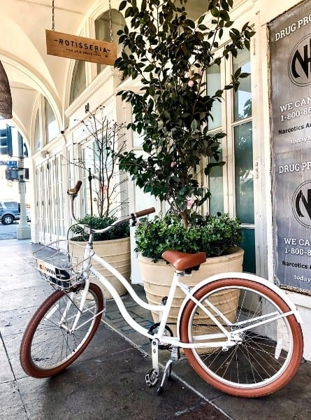 A bike is parked in front of Rotisseria in Venice California