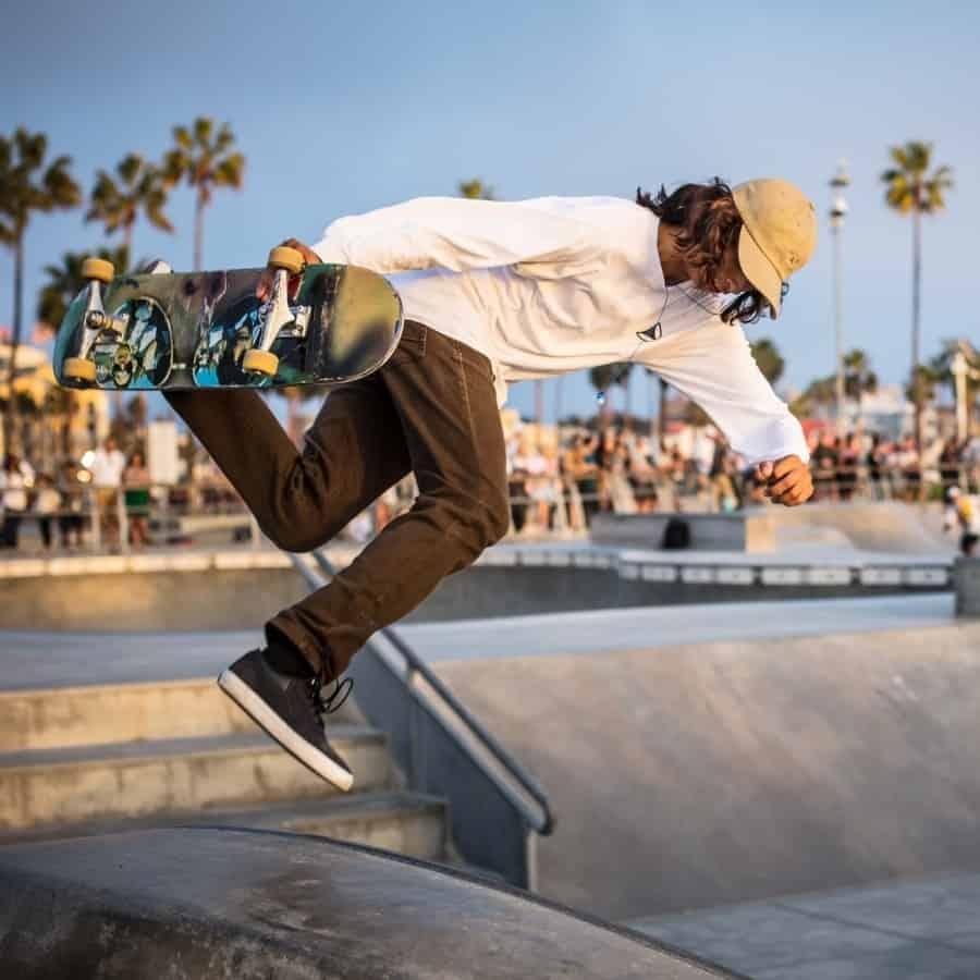 A skateboarder does a trick at the skate park Venice Beach California