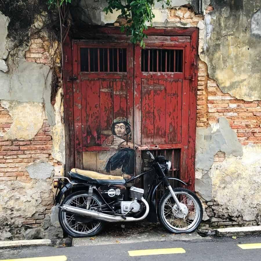 Boy On Motorbike street mural in Penang Malaysia
