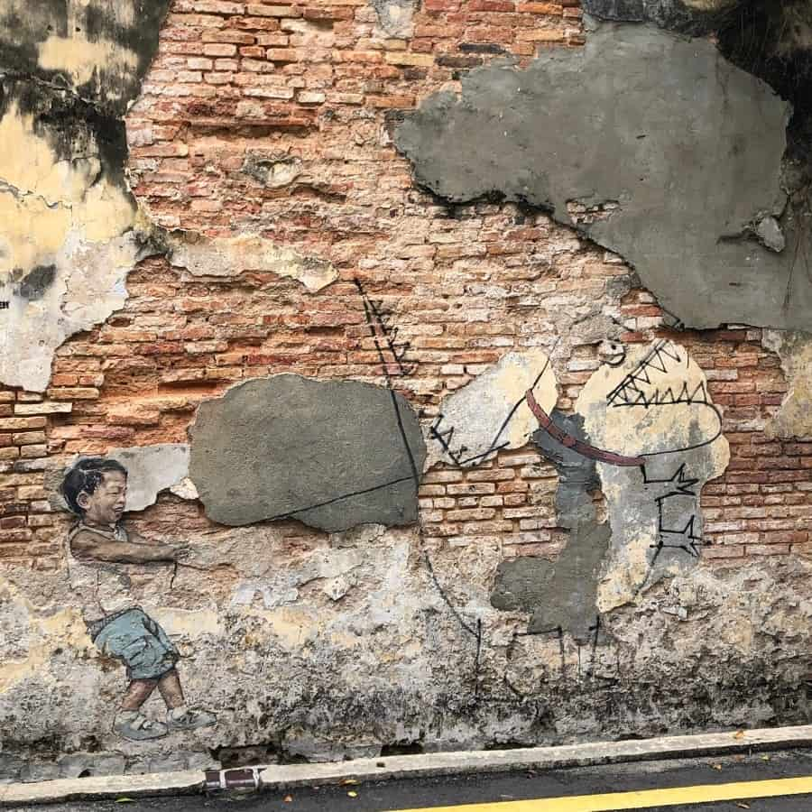 Little Boy and Pet Dinosaur Mural in George Town, Malaysia