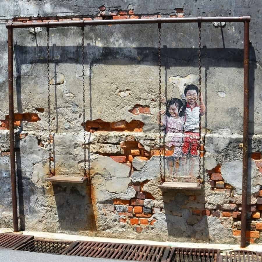 Brother and Sister on a Swing mural in Penang