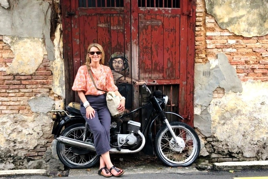 Susan Heinrich with Boy on Motorbike Street Art in Penang Malaysia