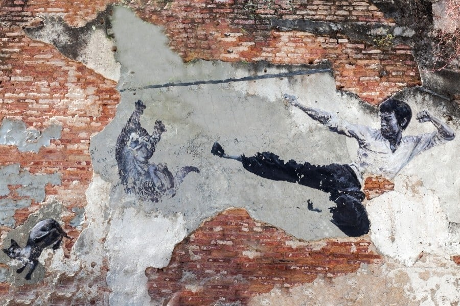 A mural of Bruce Lee and a cat in Penang