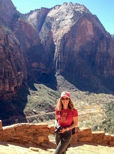 Susan Heinrich hiking in Zion National Parkon a road trip from Denver