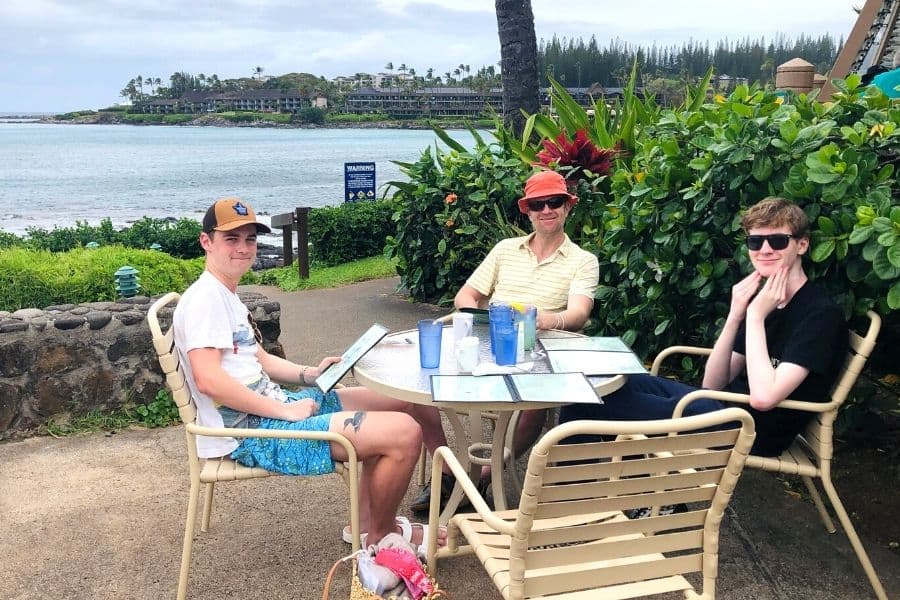 A family enjoys breakfast with an ocean view at Gazebo in Napili Maui
