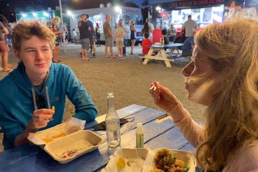 Susan Heinrich and her son Nate eat at a picnic table in theHoopiilani Food Truck Park in Kaanapali Maui