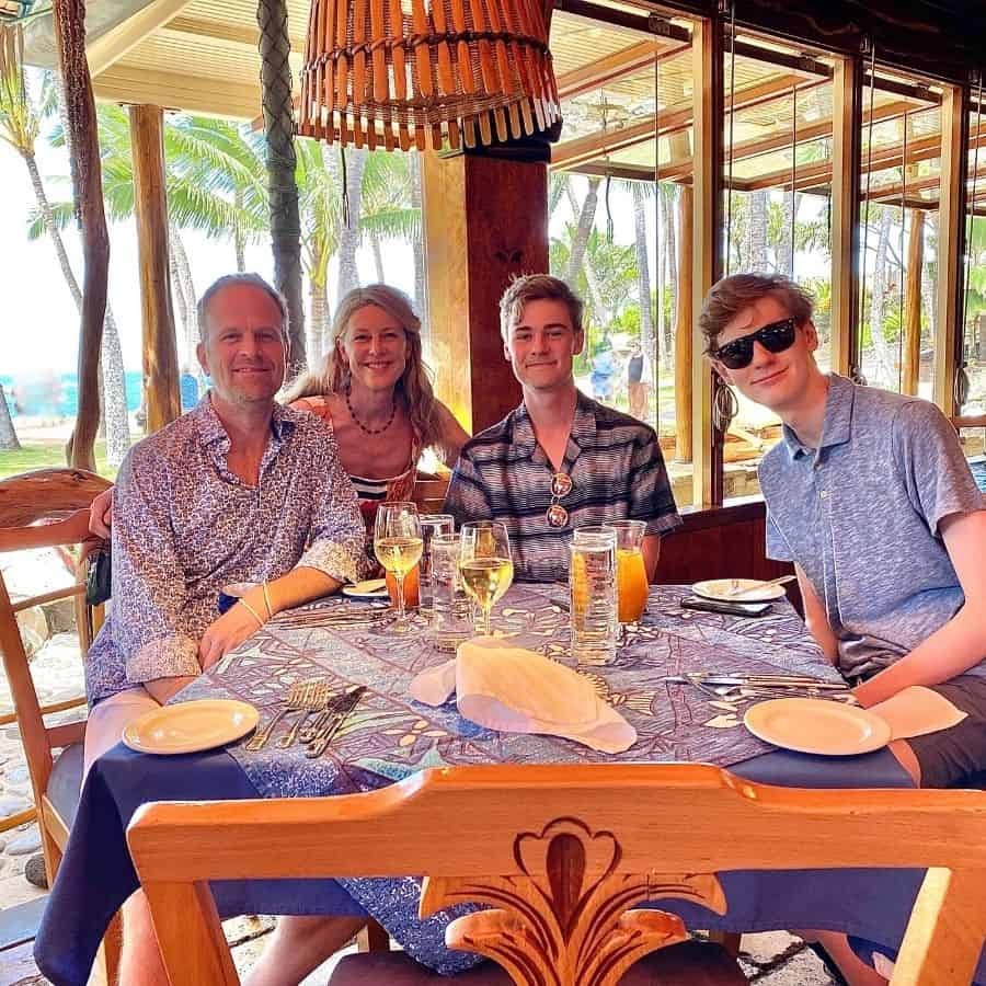 Susan Heinrich and her family at a table at Mama's Fish House