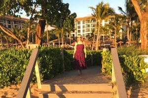 Susan Heinrich walks toward the beach at the Westin Nanea Ocean Villas in Maui