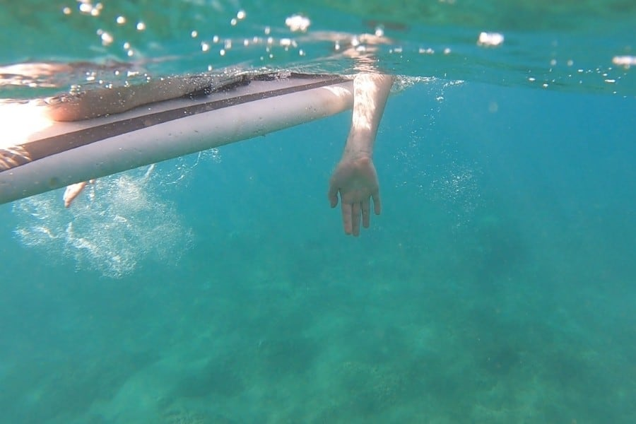Underwater view a surfboard in the ocean off Kaanapali Beach Maui